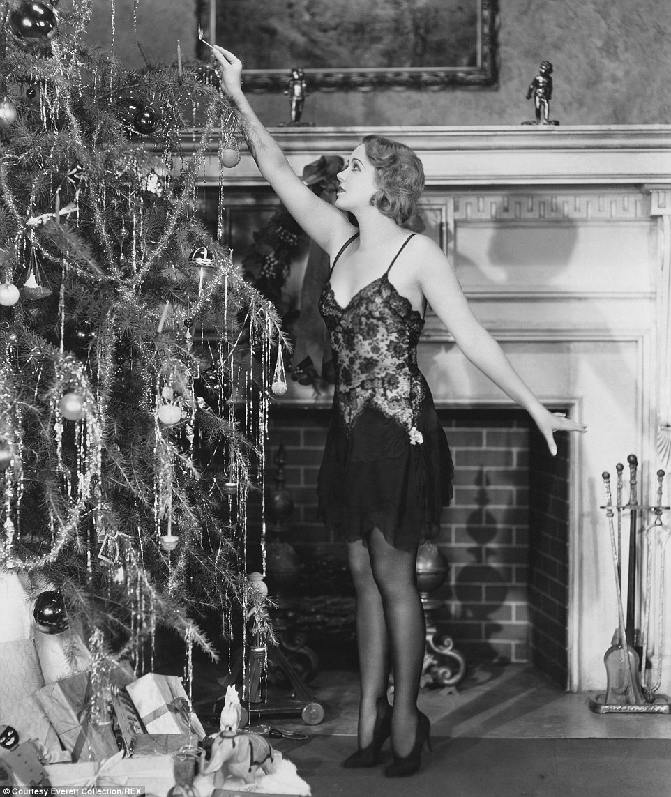 2433c87800000578-2882750-a_young_woman_with_a_gorgeous_dress_lighting_candles_on_christma-m-104_1419188705314